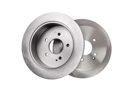 2 brake discs lies one on top of the other, car spare parts top view isolated on white background.