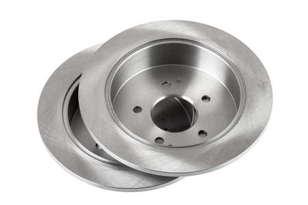 a pair of brake discs lies one on top of the other, car spare parts isolated on white background.