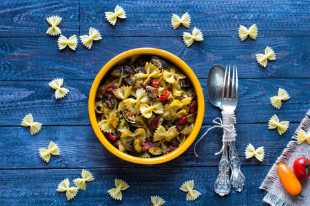 Italian pasta with vegetables: zucchini, tomatoes, peppers and potato