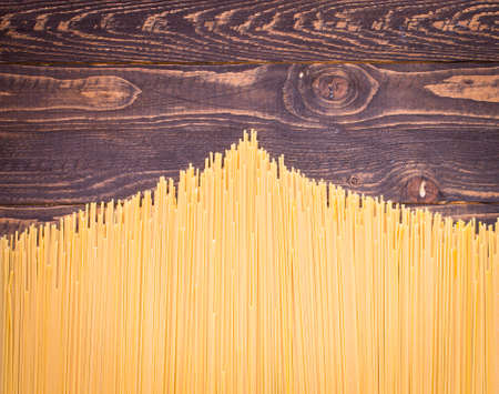 Close-up of decorating Italian pasta. Concept of traditional cuisine and healthy meal. On a wooden background