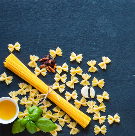 traditional pattern: Pasta background. Several types of pasta homemade,  Free space for text. Top view Stock Photo