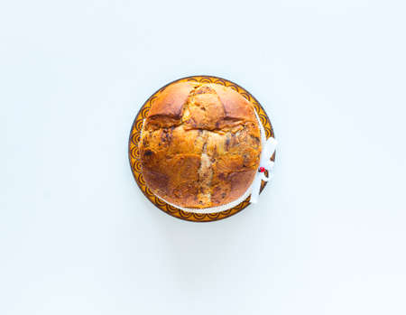 Italian chocolate panettone Christmas cake with bauble decorations, candles,pine cones, on a wooden background. Free space for text Standard-Bild