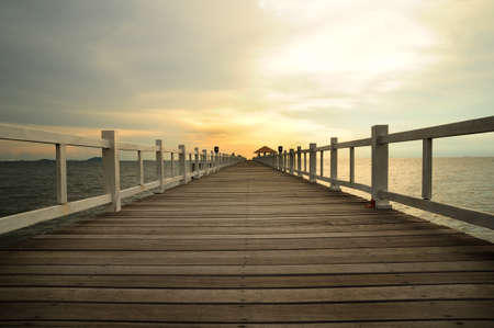 wooden bridge into the sea photo
