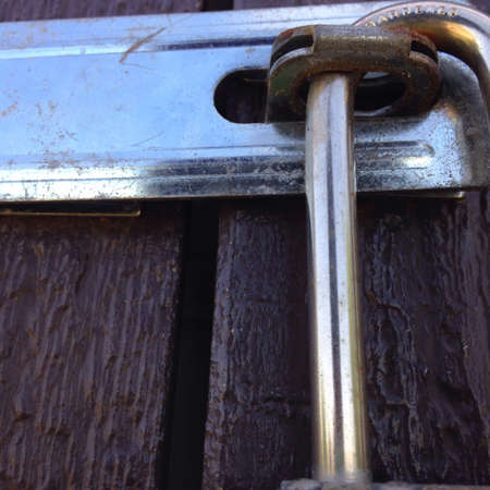 silver: Closeup of lock on shed door Stock Photo