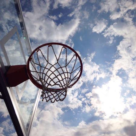 hope: Basketball hoop with sky backdrop
