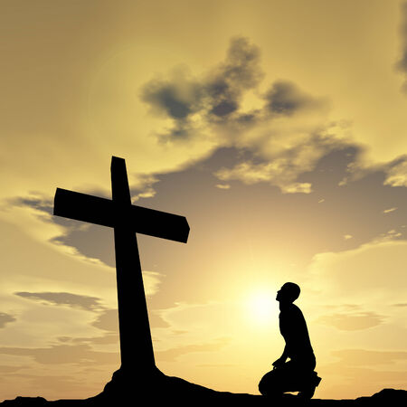 Conceptual religion black cross with a man praying at sunset photo