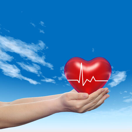 3D conceptual heart with pulse held in hands for health designs photo