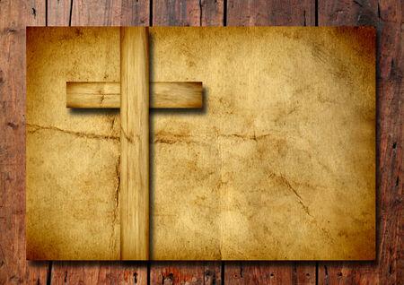 christian religion: Old vintage Christian paper cross over wood wall background Stock Photo