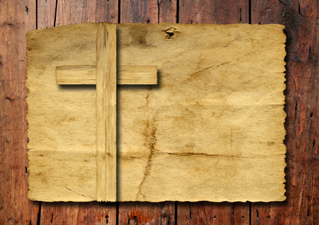 religious symbols: Old vintage Christian paper cross over wood wall background Stock Photo