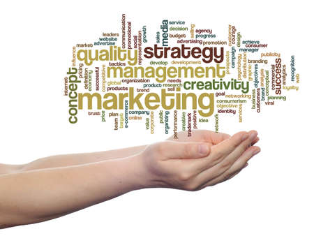 Conceptual business word cloud in hands isolated on background photo
