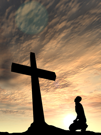 cross light: Conceptual religion black cross with a man praying at sunset