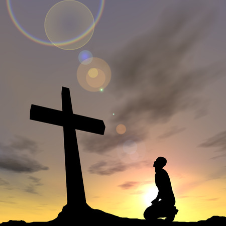 Conceptual religion black cross with a man praying at sunset