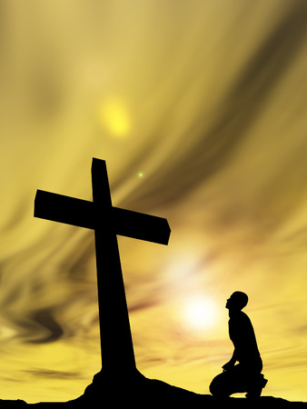Conceptual religion black cross with a man praying at sunset Banco de Imagens - 36020774
