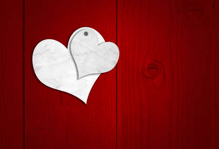 nailed: Concept or conceptual two white old paper vintage hearts nailed on red wood or wooden background for Valentine`s day Stock Photo