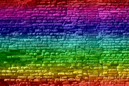 urban culture: Conceptual old vintage colorful rainbow painted brick wall background