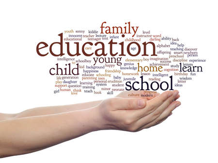Conceptual education word cloud in hands isolated on background photo