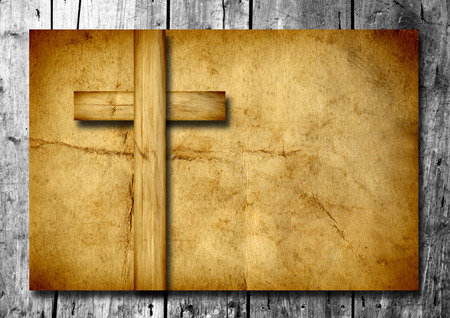 Old vintage Christian paper cross over wood wall background Standard-Bild
