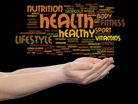 Conceptual health word cloud in hands isolated on background photo