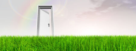 White door in green grass with rainbow sky background banner photo