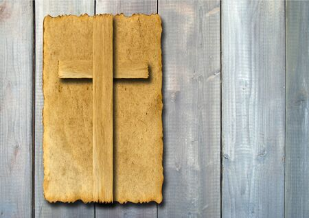 grunge border: Old vintage Christian paper cross over wood wall background Stock Photo
