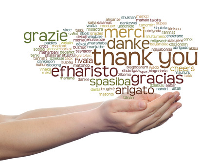 Conceptual thank you multilingual word cloud in hands isolated on background Banco de Imagens - 37633153