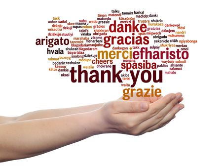 Conceptual thank you multilingual word cloud in hands isolated on background