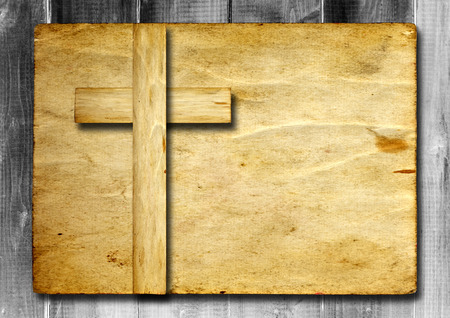 Old vintage Christian paper cross over wood wall background Banco de Imagens - 38760575