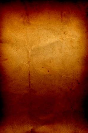 burned paper: Conceptual old vintage brown burned paper background