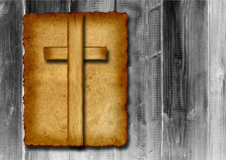 Old vintage Christian paper cross over wood wall background photo