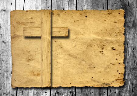 Old vintage Christian paper cross over wood wall background Standard-Bild