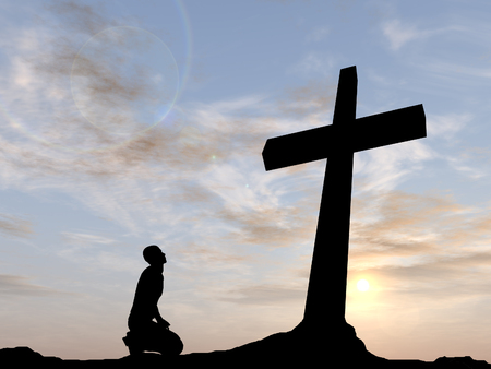 beautiful jesus: Conceptual religion black cross with a man praying at sunset background Stock Photo