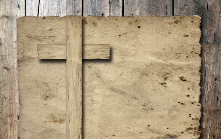 Old vintage Christian paper cross over wood wall background 스톡 콘텐츠