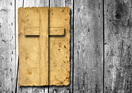 religious: Old vintage Christian paper cross over wood wall background Stock Photo