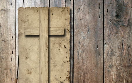 religious symbol: Old vintage Christian paper cross over wood wall background Stock Photo