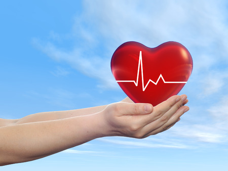 medical heart: Concept or conceptual human hand with heart and blue sky background