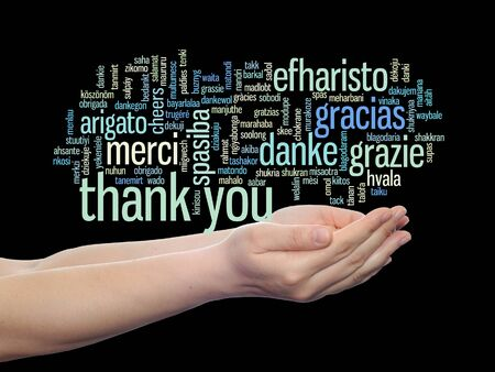 multilingual: Conceptual thank you multilingual word cloud in hands isolated on black background Stock Photo