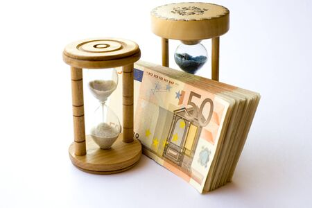 wealth management: Concept or conceptual euro paper money banknote with a sand glass or time background
