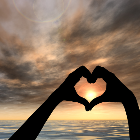 Conceptual heart shape sunset silhouette background