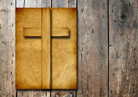 christian cross: Old vintage Christian paper cross over wood wall background Stock Photo