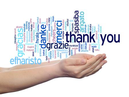 merci: Conceptuel merci texte multilingue nuage dans les mains isol�s sur fond Banque d'images