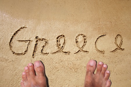 water wave: Conceptual Greece text in sand and water wave background