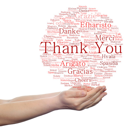 held: Concept or conceptual abstract thank you word cloud held in hands different language, multilingual as education or thanksgiving day