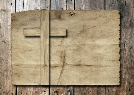 religious cross: Old vintage Christian paper cross over wood wall background Stock Photo