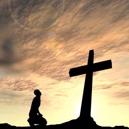 Conceptual religion black cross with a man praying at sunset background Standard-Bild