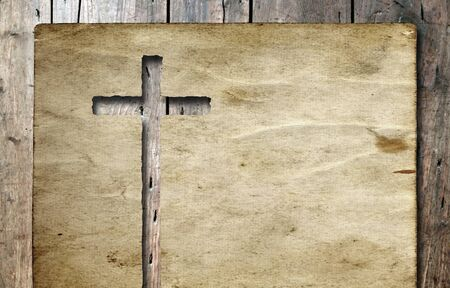holy cross: Old vintage Christian paper cross over wood wall background Stock Photo