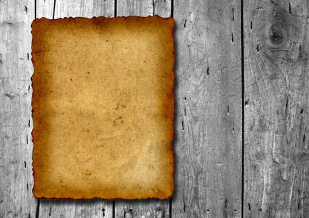 Vintage old grungy paper banner over an ancient wood texture background