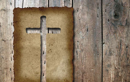 cross cut: Conceptual Christian cross cut in an old grungy or vintage paper, over a wood texture background for religion Stock Photo