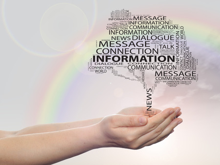 Concept or conceptual tree word cloud in man or woman hand on rainbow sky background Stock Photo