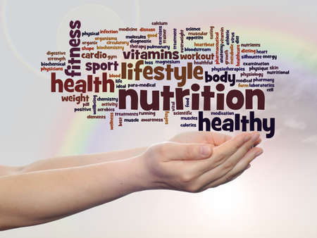 Conceptual health word cloud in hands over rainbow sky background
