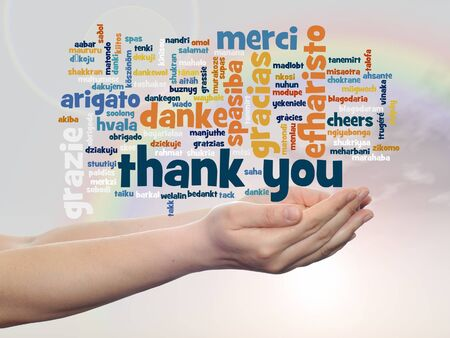 multilingual: Conceptual thank you multilingual word cloud in hands on rainbow sky background